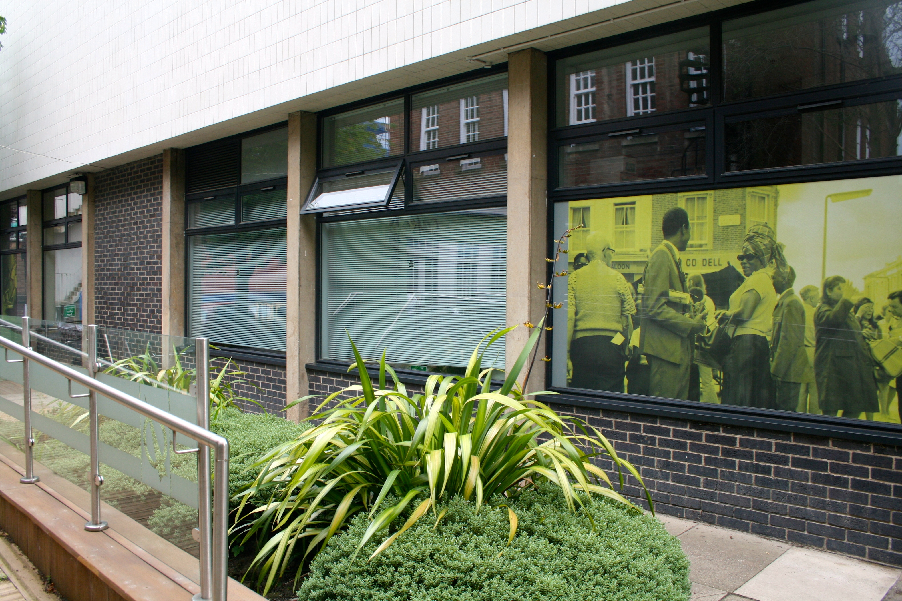 Photograph of the Museum Studies building with one of the 100 Images printed onto one of the windows