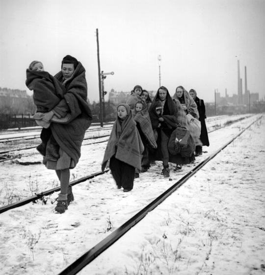 A handful of survivors from the 150 refugees who left Lodz in Poland two months earlier headed for Berlin. They are following railway lines on the outskirts of Berlin in the hope of being picked up by a British train. (Photo by Fred Ramage/Getty Images)